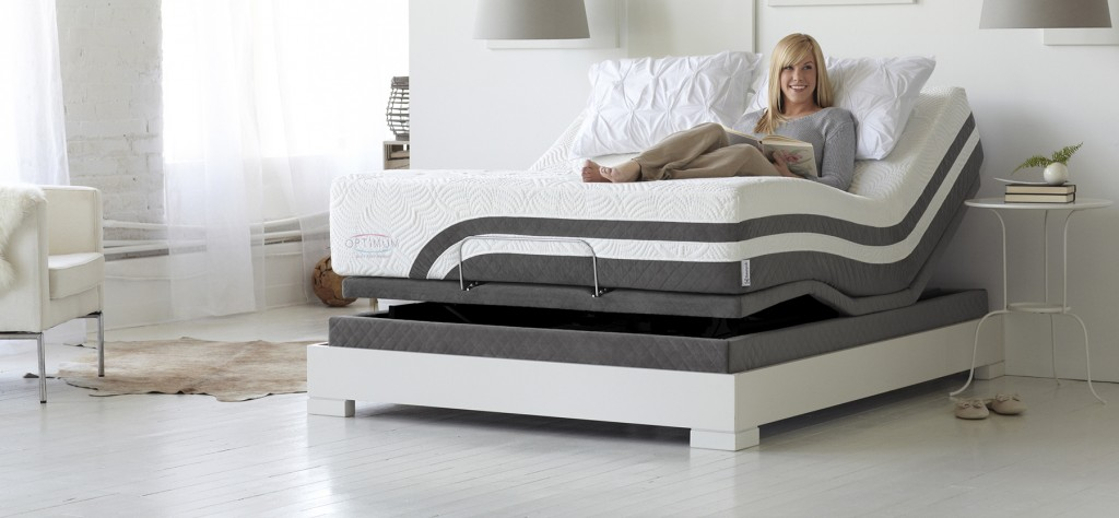 Image of woman sitting on the adjustable base mattress line in modern bedroom