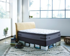 stripped Sealy Posturpedic bed in showroom