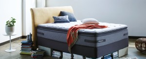 unmade Sealy bed