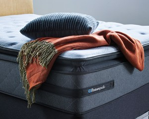 Sealy Posturpedic mattress with blanket and pillow