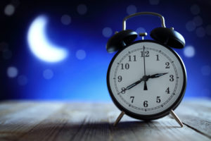 Alarm clock in the middle of the night insomnia or dreaming