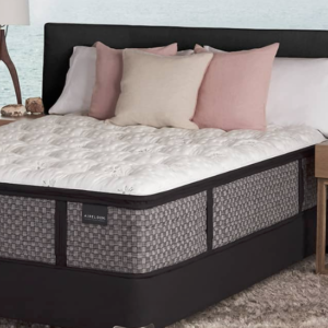 made bed in bedroom furnished with end tables