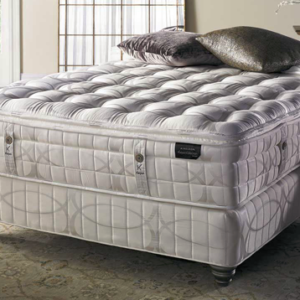 luxurious plush mattress in elegant bedroom with satin pillows