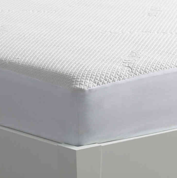 close up of white mattress protector