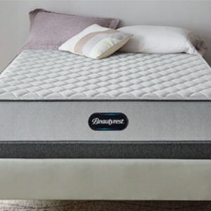 white and grey mattress on ivory bed frame