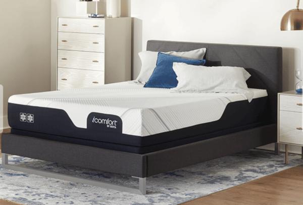 black and white mattress on black bed frame