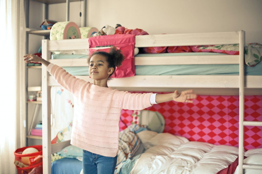 image of female child in front of bunk bed