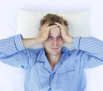 A man not able to get to sleep because of stress, insomnia