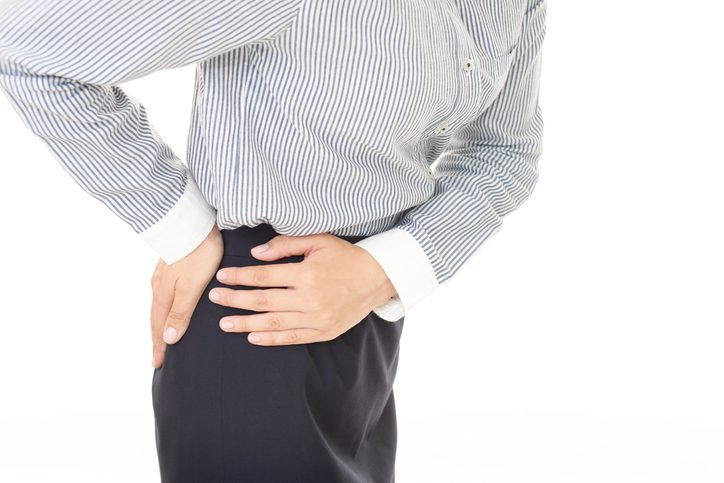 Woman who has back and hip pain